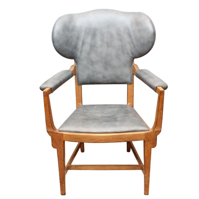 An Interior Crafts chair upholstered in blue-grey leather. Made in Chicago.