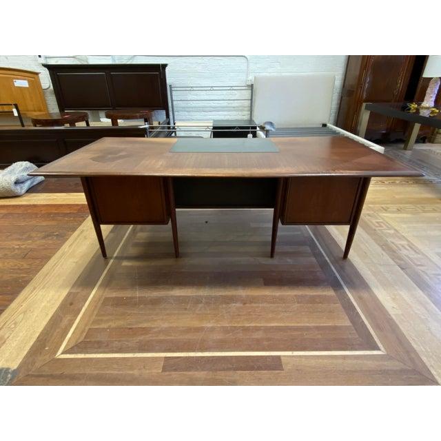 Design Plus Gallery presents a Mid 20th Century Walnut + Mahogany Castilian Series Desk by Alma Furniture. Influenced by...