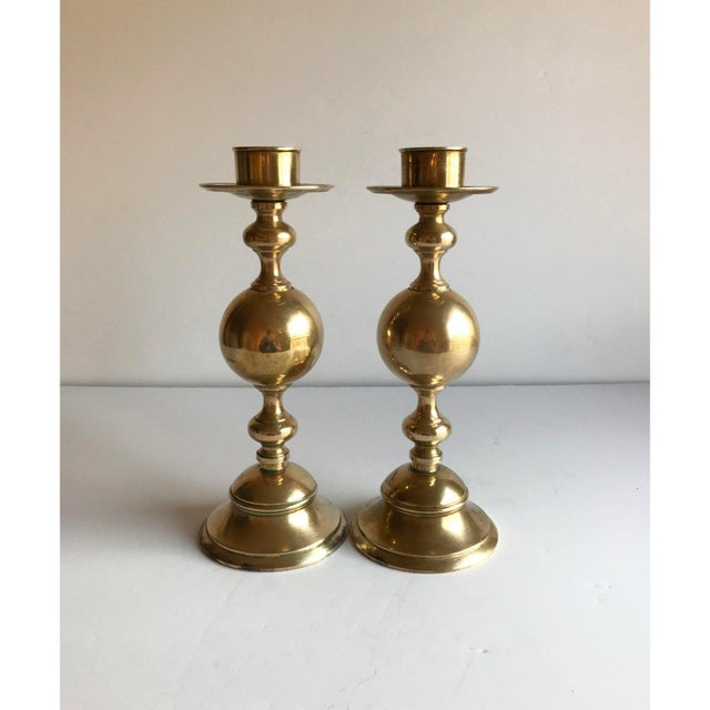 A pair of vintage brass candle holders, with sculptural design and substantial weight. Beautiful addition to your holiday...