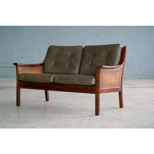 Beautiful Torbjorn Afdal designed sofa in stained beech with top grain olive colored leather cushions and woven double...