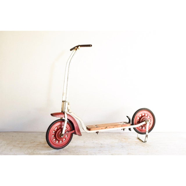 • Vintage children's push scooter circa 1940. • White metal body, vibrant red wheels and accents and red and white wooden...