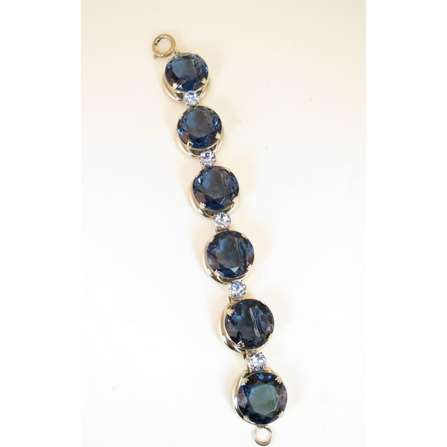 Offered here is a massive German silver-plated link bracelet featuring sapphire headlamp crystals, from the 1950s. Round...