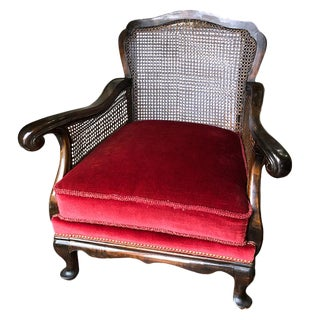 Vintage Red Velvet Carved Bergère Armchair With Cane Sides and Back For Sale
