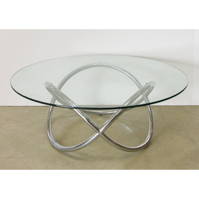 Vintage American chrome coffee table with round glass top. Made in the United States of America in the 1960's. 1 in stock...