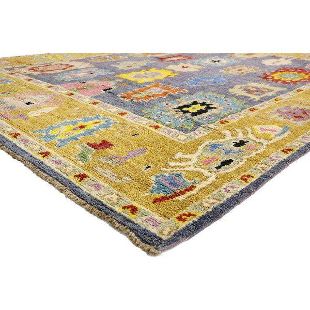 This hand knotted wool contemporary Moroccan area rug showcases an Oushak design with a Memphis style. The all-over large-...