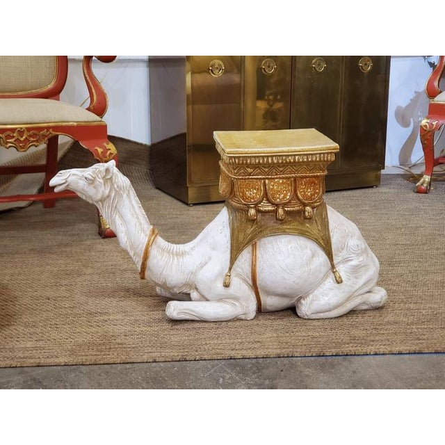Delightful floor accent piece. Add Eastern flare to any room by adding a fern resting on the back of this large ceramic...