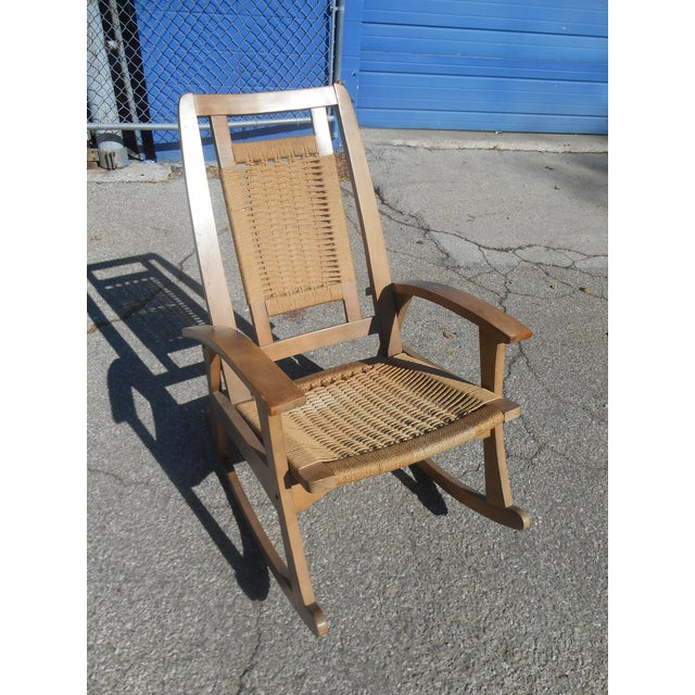 Mid-century modern Yugoslavian Rocking Chair. Sit back and relax in this vintage woven cord rope rocking chair, it is...