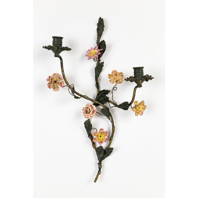 A pair of fantastic, antique, French tole candle holders of intertwining vines; with dusty pink, yellow, and white...