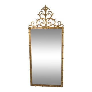 1940s Classical Style Gold Metal Mirror With Rosette Decoration Scrolled Finial Top For Sale