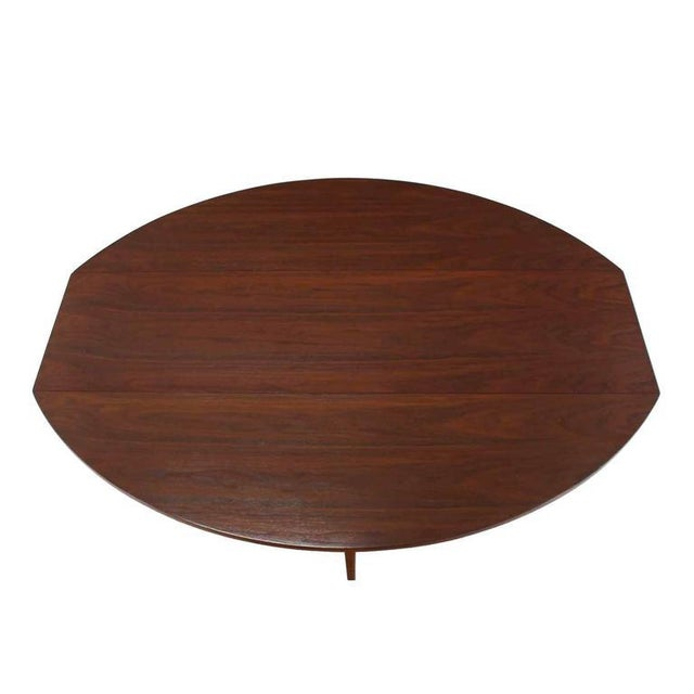 Mid-Century Danish modern walnut drop leaf dining table.