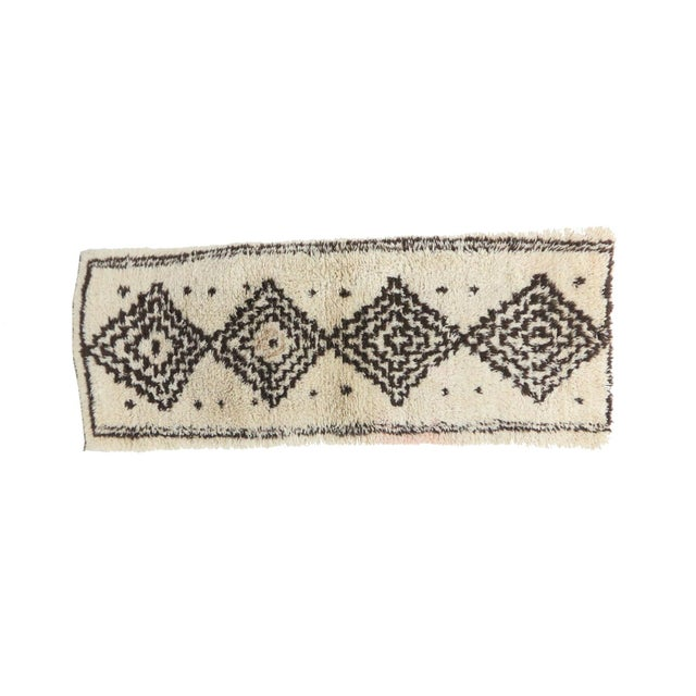 "Moroccan Rug handwoven by women of the Azilal tribe in the Middle Atlas Mountains. Type: Azilal Dimensions: 2'7"" x 6'8""..."