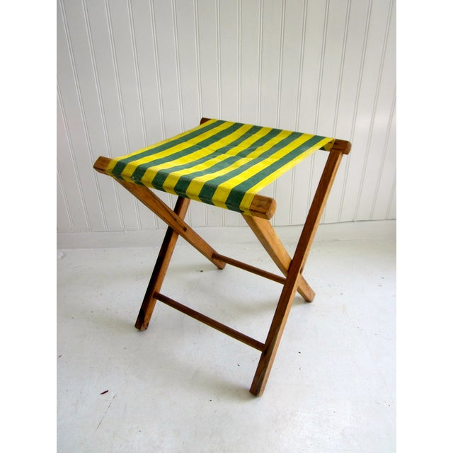 An adorable folding stool with a zippy striped fabric seat. This is a rustic, wood camp chair with colorful canvas...