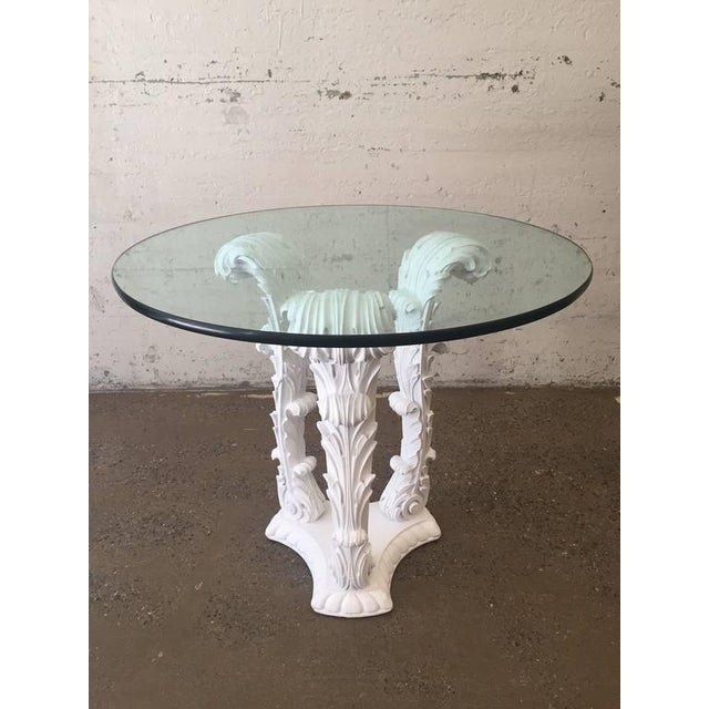 Pair of Serge Roche Carved Wood Tables. Tables are white lacquered on a solid, carved wood base.