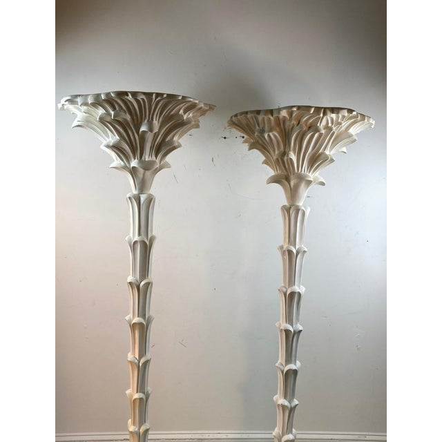 """Exceptional pair of carved wood floor lamps in the manner of Serge Roche. Each measure 69"""" and 19"""" diameter. 21st century...."""