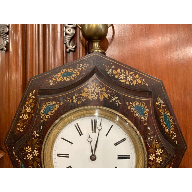 This feminine wall clock was created in France, circa 1870. Octagonal in shape, the antique tole time keeper features a...