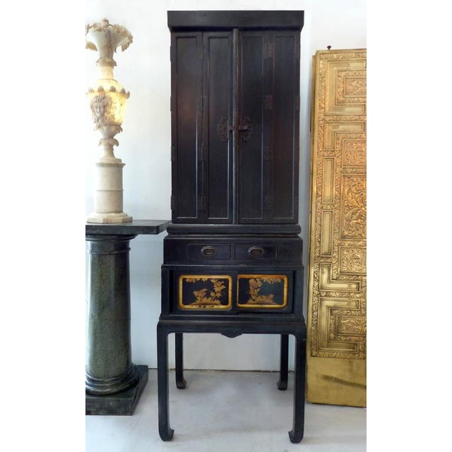 A rare very large black lacquer and giltwood Japanese Buddhist temple with the original stand. Circa turn of the last...