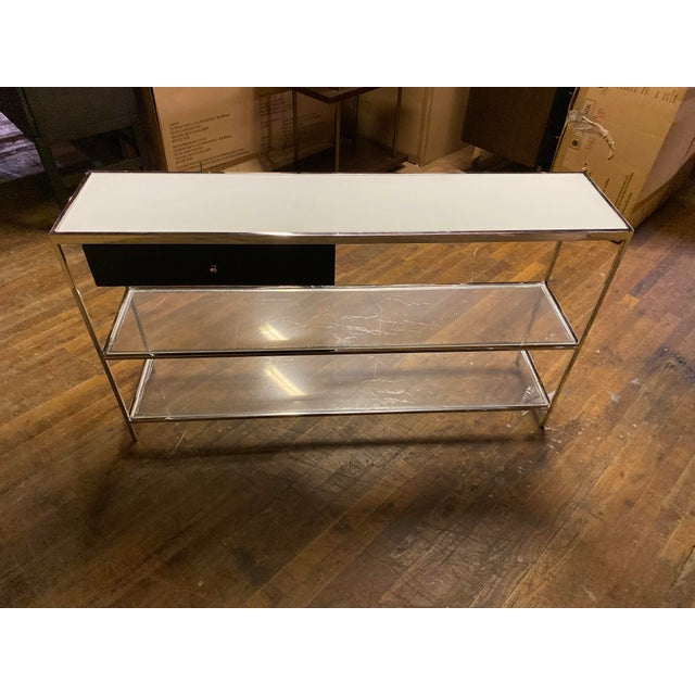 This Mitchell Gold Manning console table has one drawer and is new with plastic still on the glass. This has been in the...