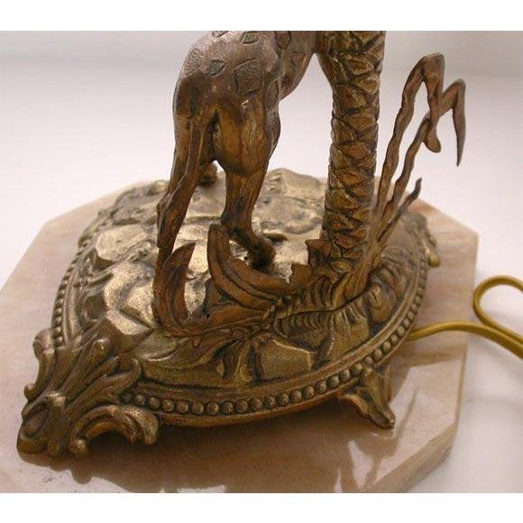 A very detailed and unusual table lamp that will help you accessorize a special space. The giraffe, palm tree, and...