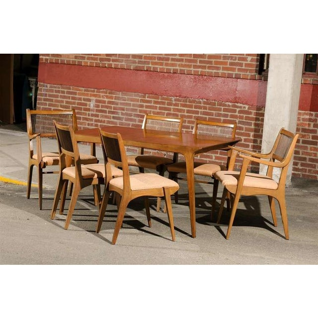 This Mid-Century Modern dining suite of ash wood is in the original condition and designed by John O. Van Koert for...