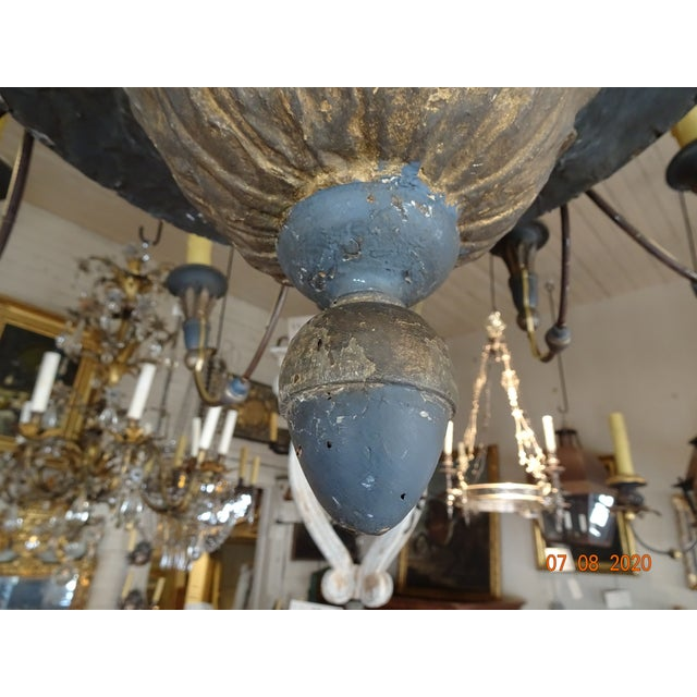 Early 19th Century Italian chandelier. Iron arms. 12 lights. US wired. Wood bobeches. Canopy is wood with gilt. The main...
