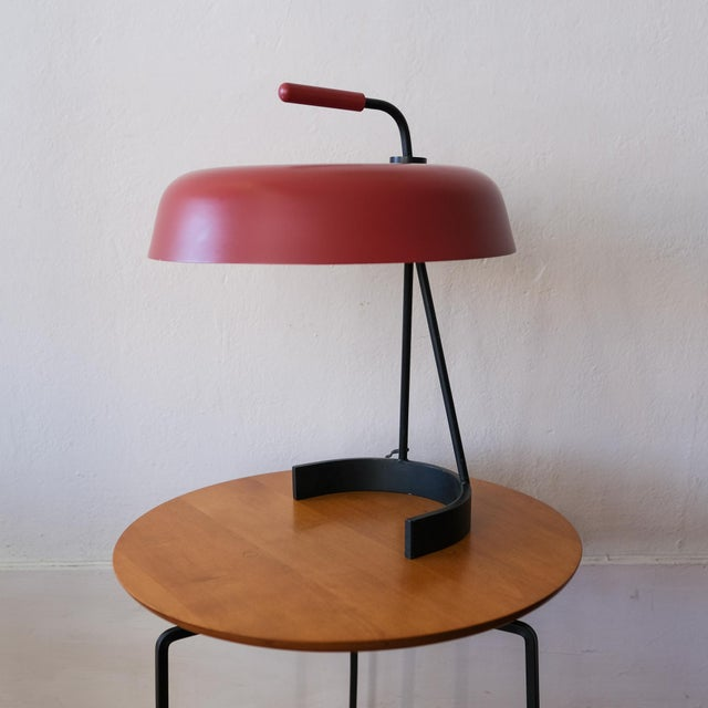 Desk or table lamp with formed metal shade and iron base. Inline switch on European wiring. An adapter will be supplied,...