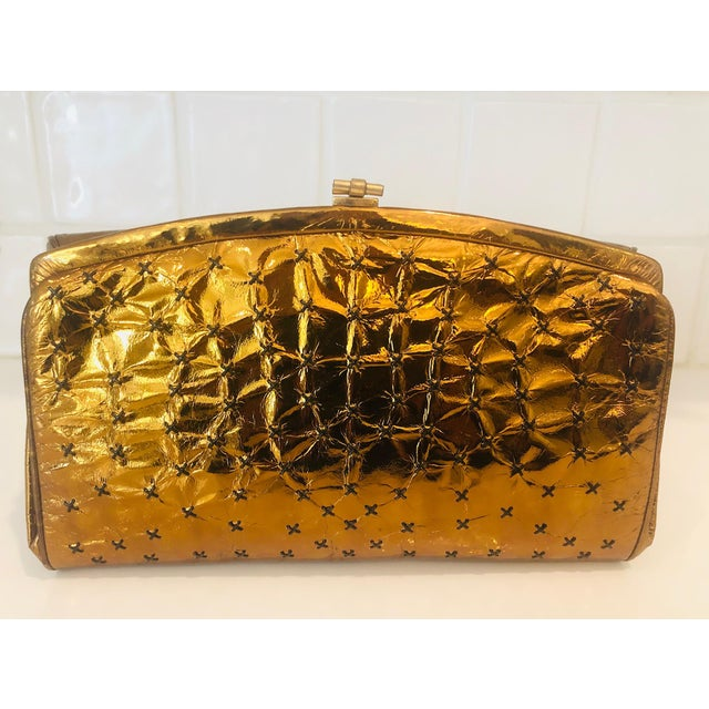 Incredibly rare clutch from iconic handbag designer Max Holzman, circa 1960s. Richly toned, metallic copper leather with...