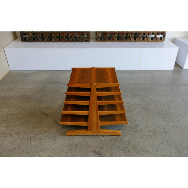 Edward Wormley walnut magazine tree table or rack model #4765 for Dunbar. Made in the mid 20th century int he style of...