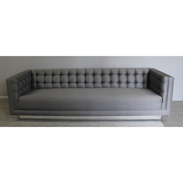 Handsome, sleek and sophisticated tufted sofa with chrome flat bar steel frame detail with new neutral gray upholstery....