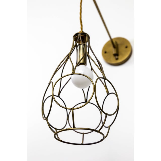 Dogfork Lamp Arts Contemporary Long Arm Hanging Brass Cage Sconce With Circle Motif For Sale - Image 4 of 12