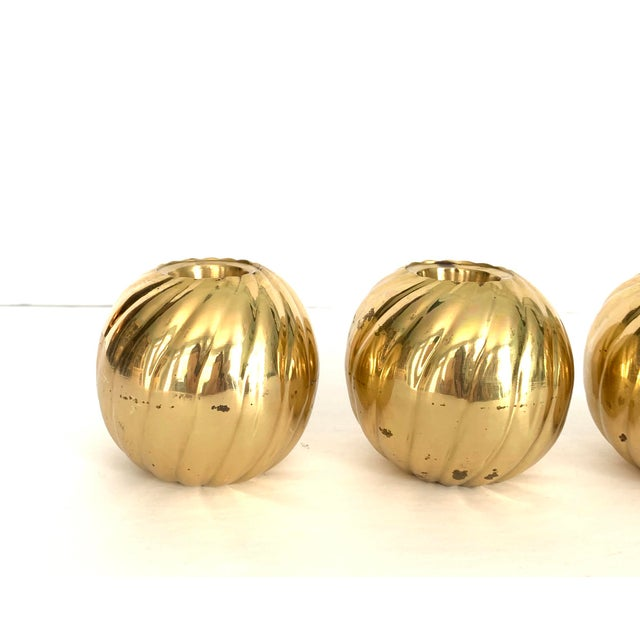 Set of 3 Modern Brass Candle Holders with a fun swirl pattern. Adds warmth to any space. Thank you for shopping with us!
