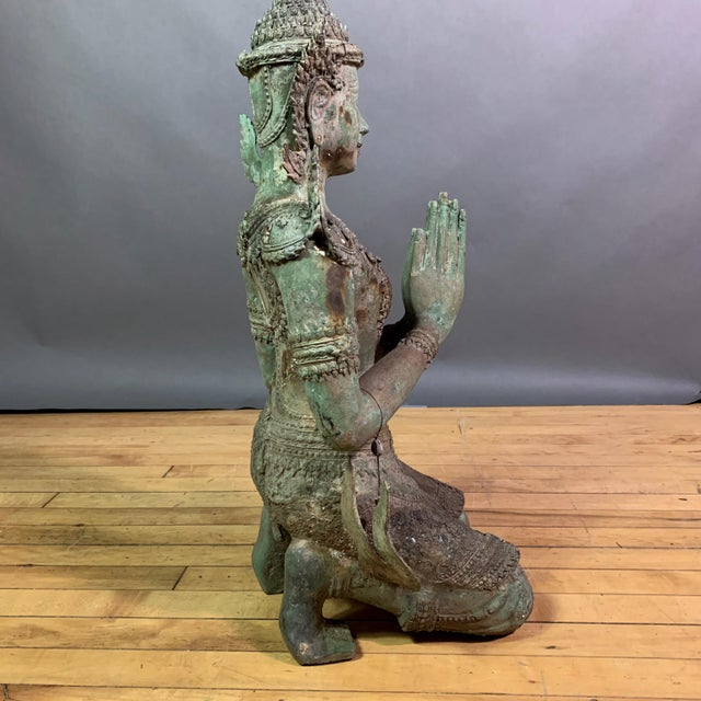"""A large 30"""" tall exceptional bronze statue depicting a female Thepphanom angel or diety traditionally a temple protector..."""