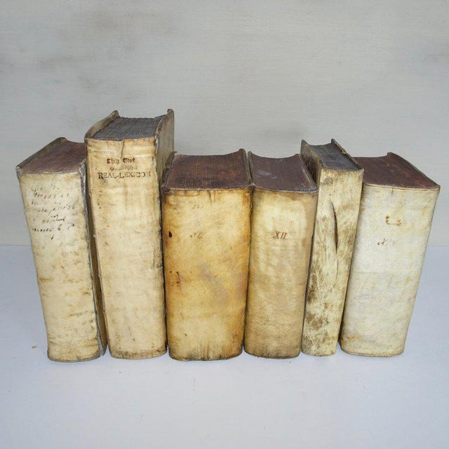 A nice collection of all Vellum books in a set of six books from the 17th and 18th century.