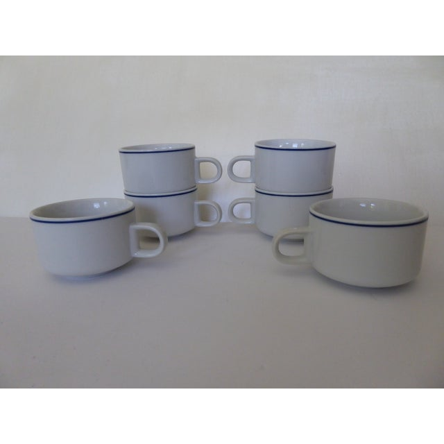 6 Heavy Stackable Stoneware Cups made in Japan, smaller compact size, very light grey in color with an understated navy...