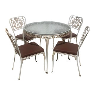 Vintage Hollywood Regency Metal Outdoor Cast Iron Round Dining Table and Four and Four Chairs For Sale