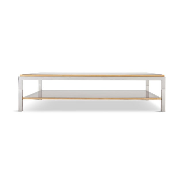 Large rectangular coffee table with two racks by Willy Rizzo. The chrome plated steel frame is finished with brass edges....
