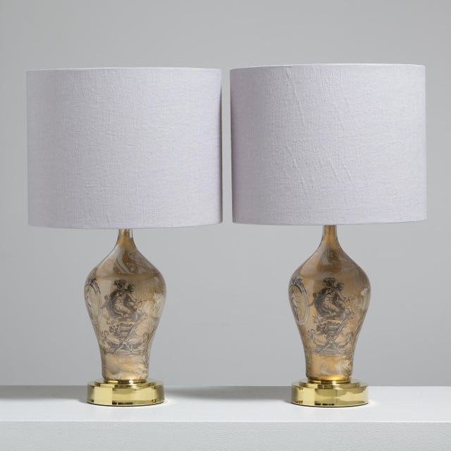 A Pair of Fornasetti Style Eglomise Glass Table Lamps on Polished Brass Mounts 1970s Price includes 20% VAT which is...