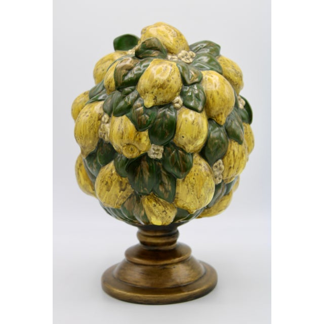 A stunning Italian style lemon topiary adorned with darling little white flowers. Golden accents throughout match the...
