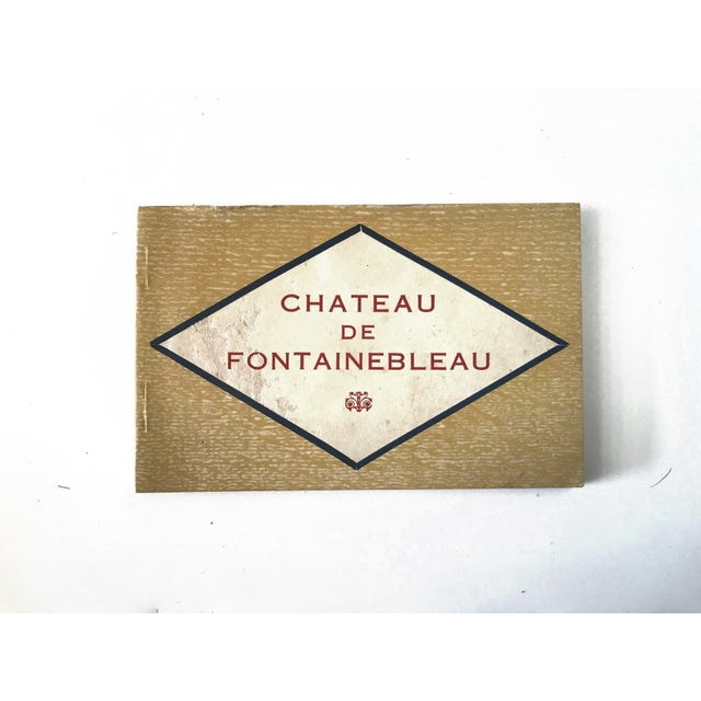 A vintage French souvenir postcard book from the Chateau de Fontainbleau, outside and inside views (including, e.g., Marie...