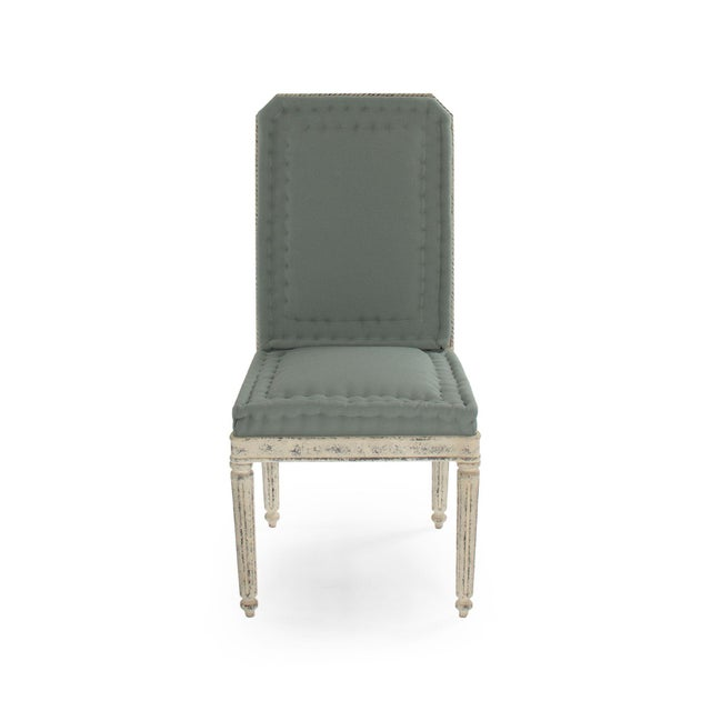 Tufted side chair upholstered in smokey green olefin on distressed off-white fiberglass frame. This chair is weatherproof...