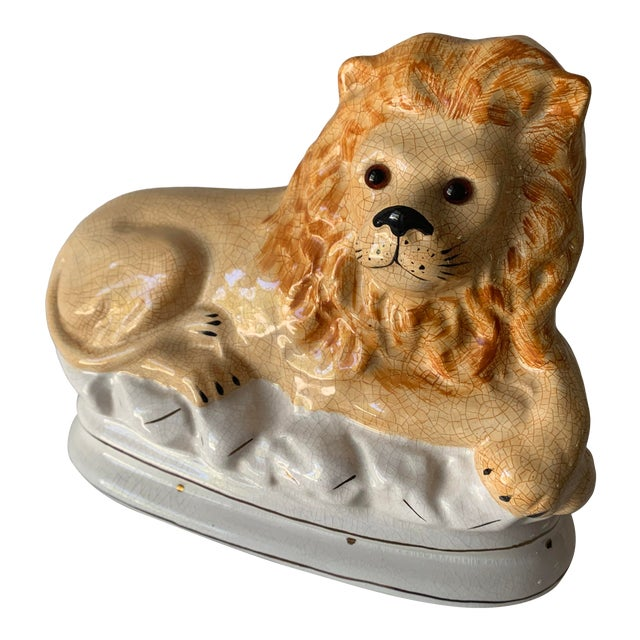 Staffordshire Earthenware Recumbent Lion With Glass Eyes For Sale
