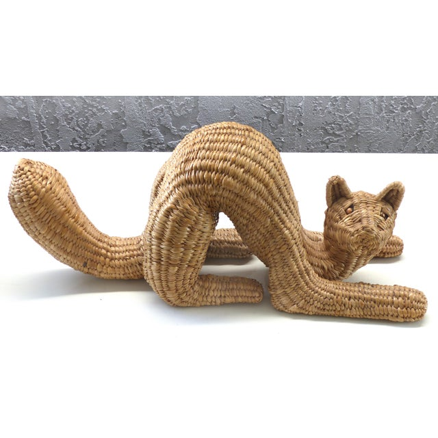 Offered for sale is a whimsical cat sculpture by Mexican folk artist Mario Lopez Torres signed and dated 1974. A highly...
