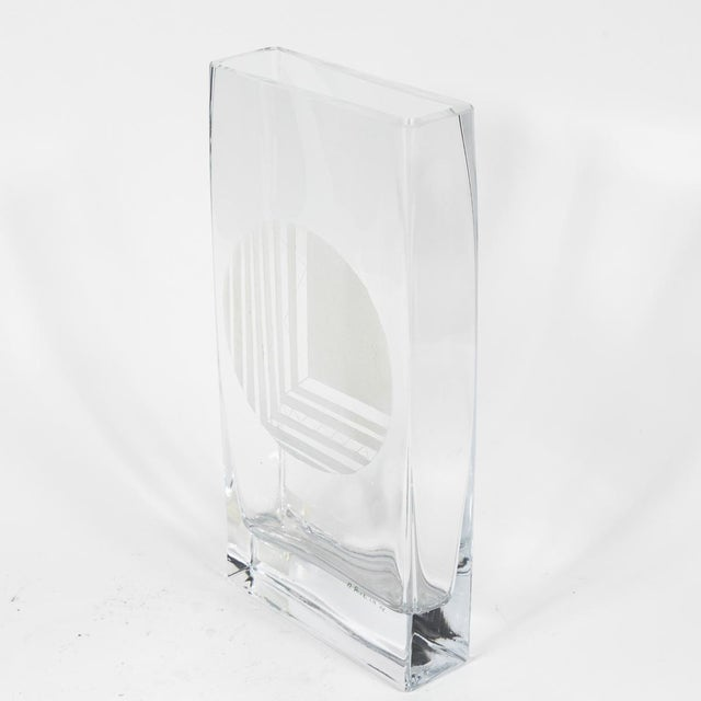 A set of glass vases with etched design in graduated sizes. Originating from France, circa 1960.