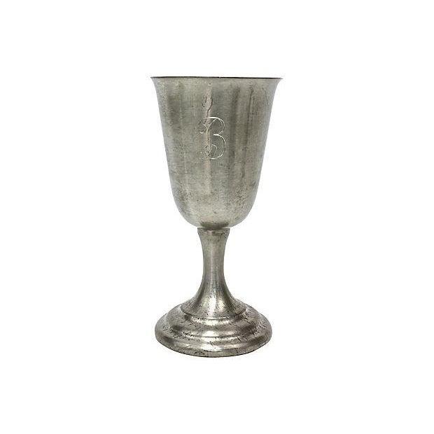 "Set of eight ""B"" monogrammed pewter liquor chalices. Maker's mark on undersides."