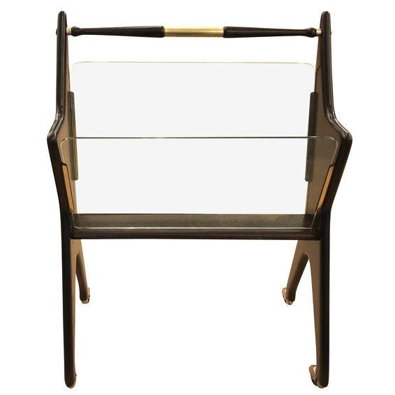 Large Cristal Art magazine stand from the 1960's. Wood frame, glass paneling and brass and metal fittings