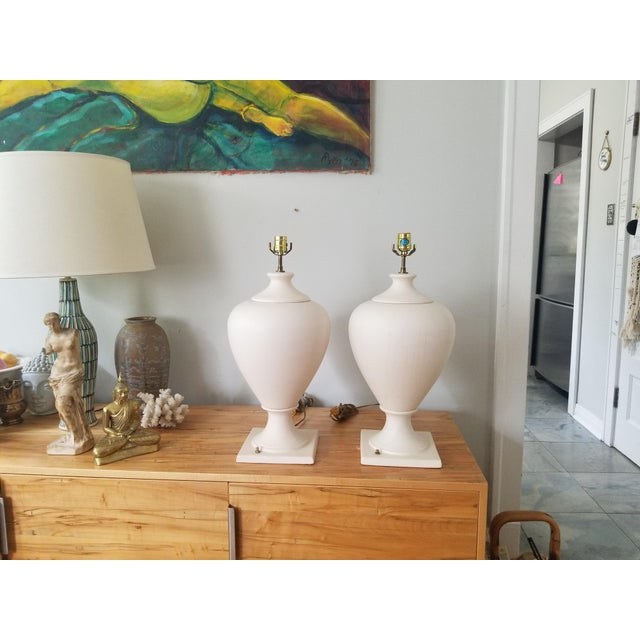 Wonderful pair of French lamps by Kostka, sculptural in appeal they elegantly and slenderly curve from narrow base to wide...