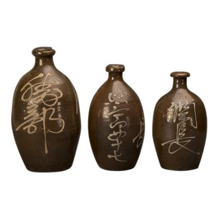 A trio of hand-made earthenware saki jars from Japan c. 1900 For Sale