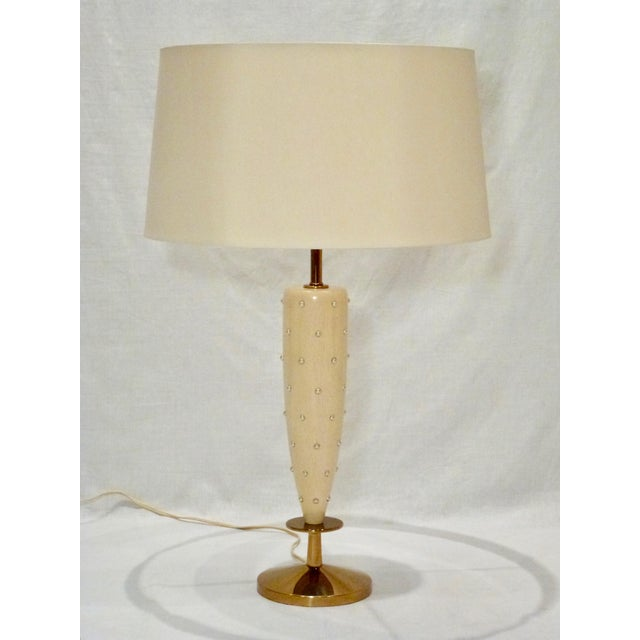 Graceful Bleached Mahogany Table Lamp with Pearlized Studs and Brass Base designed by Tommi Parzinger for Rembrandt. Shade...