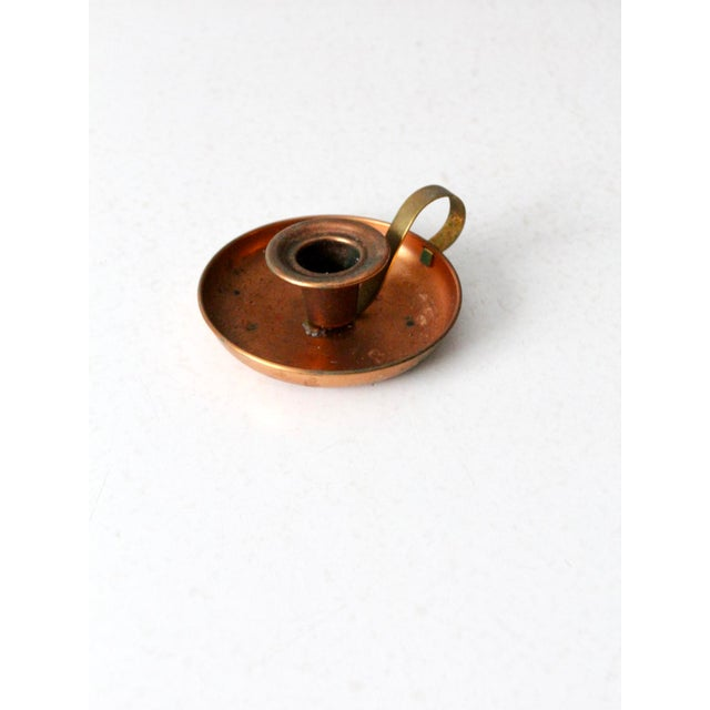 This is a vintage Coppercraft Guild copper chamberstick. The copper candle holder fits a standard taper candlestick and...