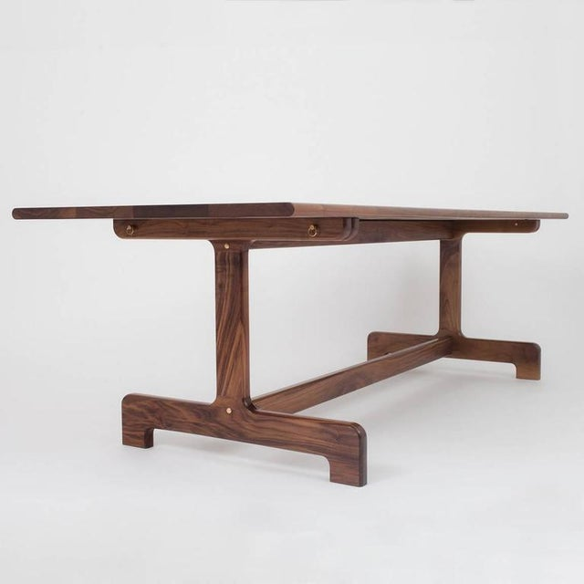 The Physalia dining table is the perfect center piece to a home or office's communal space. The clean lines provide a...