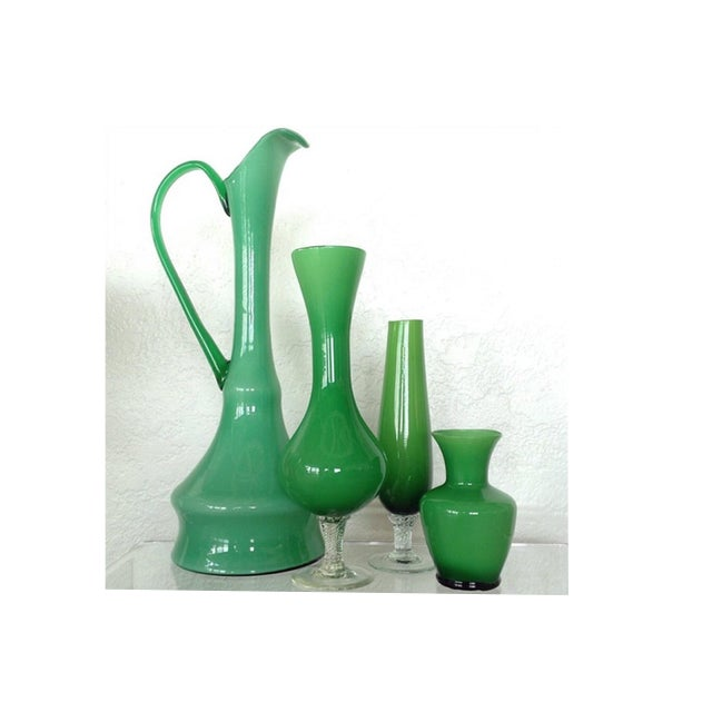 The lovely set of vessels is a vintage kit for all those lovely Spring Blooms. Starting with three vases at varying...